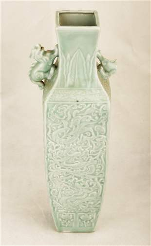 A GREEN GLAZE CARVED DRAGON AND PHOENIX PORCELAIN