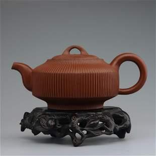 Chinese striped purple sand teapot