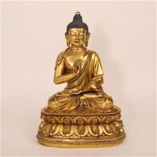 A gilded bronze statue of a fifteenth-century Buddha