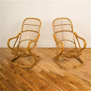 A PAIR OF ITALIAN RATTAN LOUNGE ARM CHAIRS