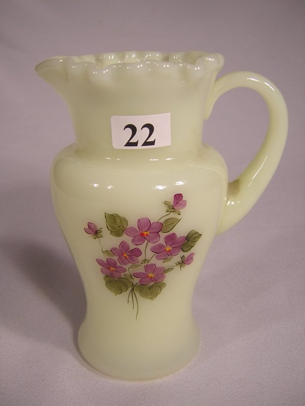 "22: Custard 5.5"" tall pitcher with applied Custard hand"