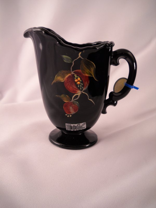 "17: Designer sample: Black 6"" tall pitcher, made with a"