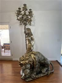 Massive goddess lamp taming a lion