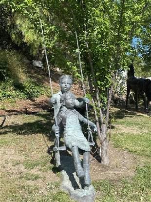 Bronze Boy and Girl On Swing