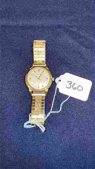 14 Kt yellow gold Movado men's watch