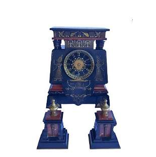 A slate and marble mantel clock garniture in Egyptian