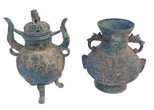 Archaic pair of heavy Chinese mythical animal urns