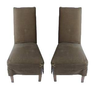 Two covered high-back dining chairs