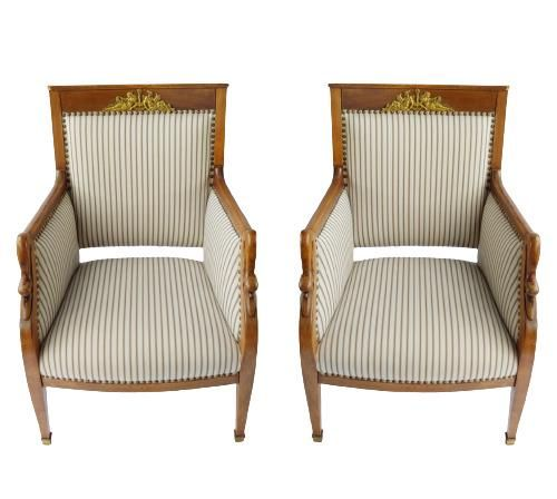 Pair of empire style gilt metal mounted berger chairs