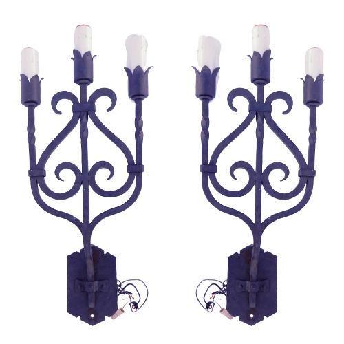 Pair of candelabra look sconces