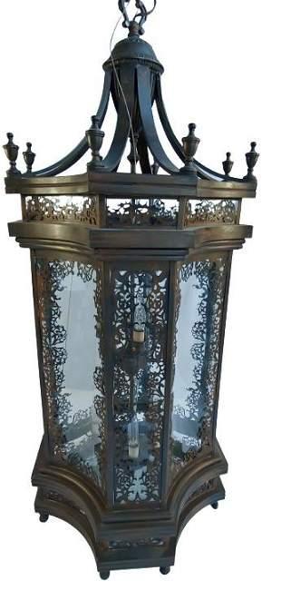 Large brass, glass paneled lantern style chandelier