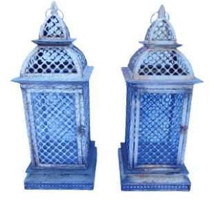 Pair of white Moroccan style metal lanterns