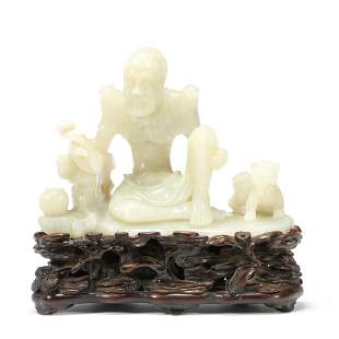 A Carved White Jade Arhat Ornament
