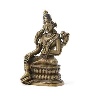 A Gilt Bronze Figure Of Avalokitesvara