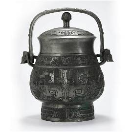 A Bronze Ritual Beast Loop-Handle Vessel You
