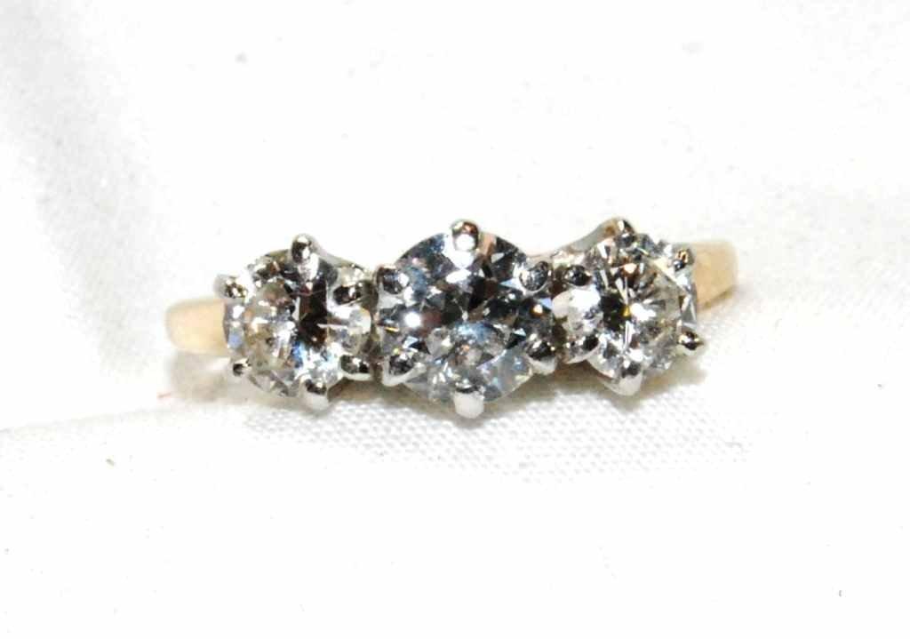 72: Vintage Three Stone Diamond Ring set in 14K Yellow