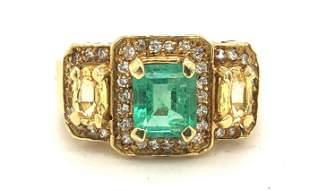 18 karat yellow gold emerald and sapphire ring
