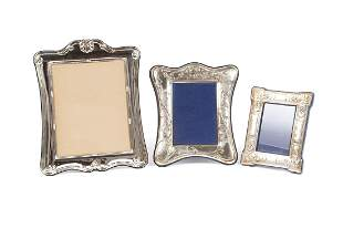 TWO STERLING PICTURE FRAMES AND ANOTHER