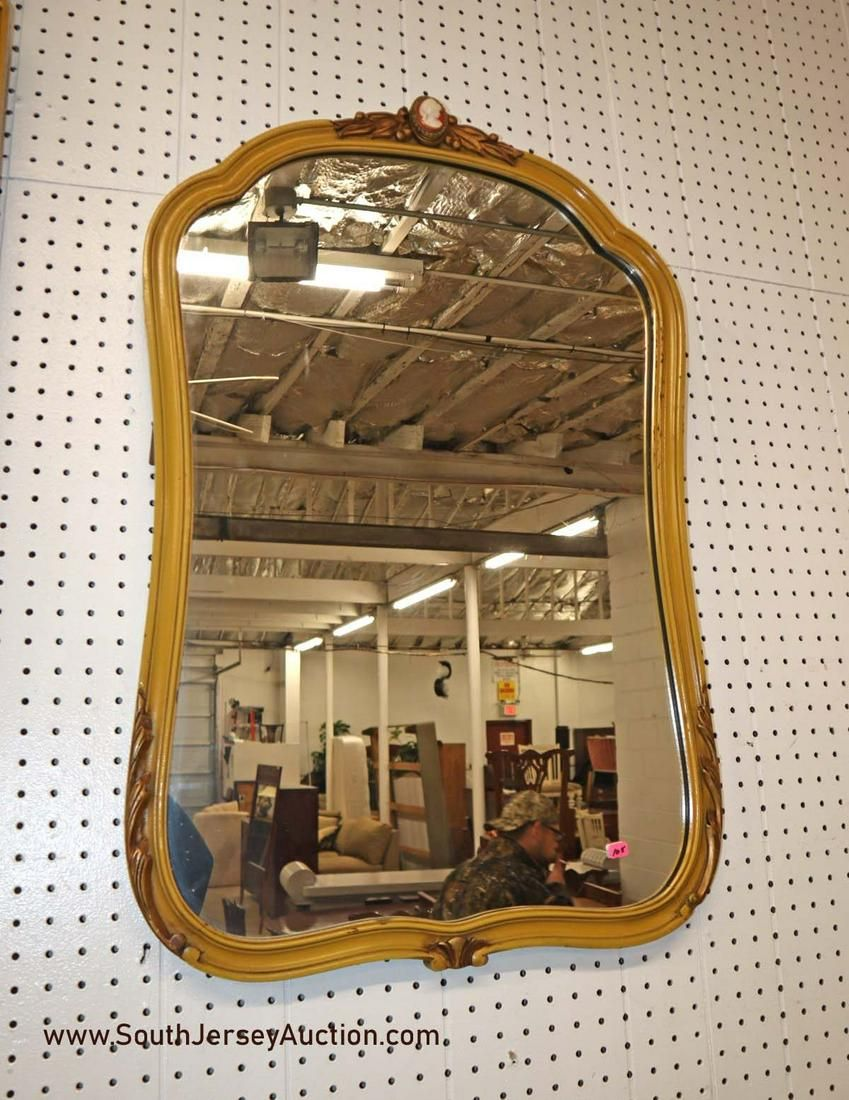 Vintage French style mirror with feather carved sides
