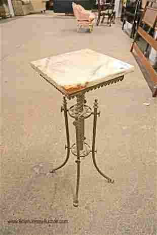 Antique brass and marble pedestal table with paw feet