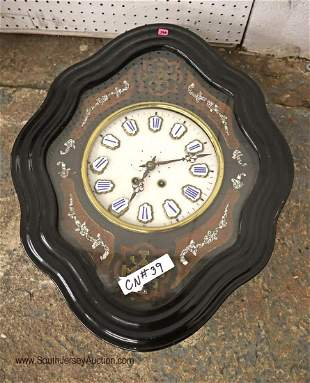Antique French porcelain wall clock with mother of