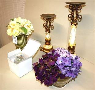 Faux flowers and decorative candle stands