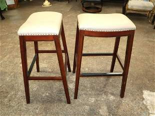 Pair of mahogany frame leather tacked barstools
