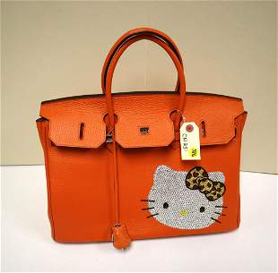 Marked Hermes leather hand bag with hello kitty