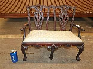 Highly carved mahogany child / doll settee