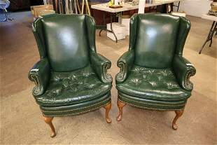 Pair of leather tacked arm chairs