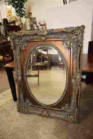 Antique style highly carved mirror