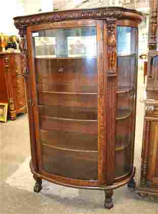 Antique oak bow front china cabinet