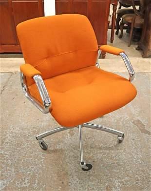 Vintage orange swivel chrome tubular arm chair