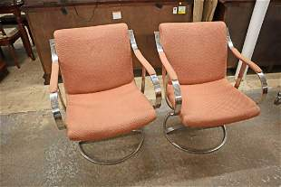 Pair vintage chrome and steel swivel arm chairs
