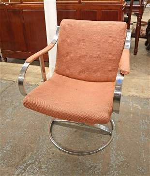 Vintage chrome and steel swivel arm chair