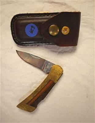 Vintage Gerber pocket knife in leather case