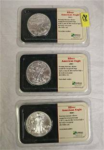 Group of 3 Silver US American Eagles dates 2001