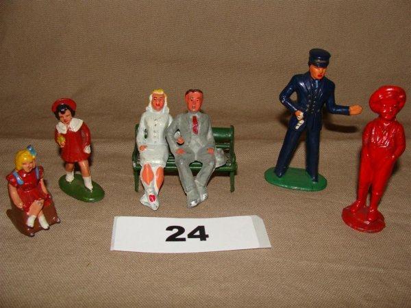 1024: Dimestore Civilian Lot (7) Pieces