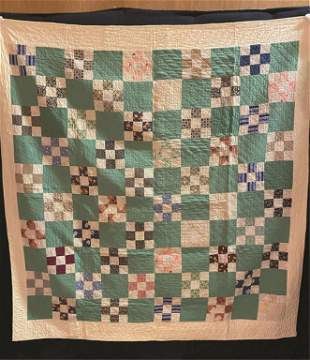 A Square Pieced Quilt with Alternating Teal and
