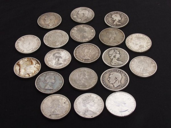 320: Canadian Coins: 19 Various Silver Dollars