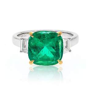 Cushion- cut Emerald Ring with Baguette Side Diamonds