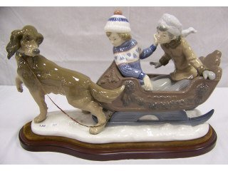 3737: Lladro figurine of dog pulling sled with two