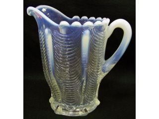 54: White opalescent water pitcher,