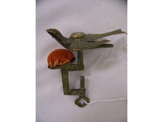 5003: Brass sewing bird
