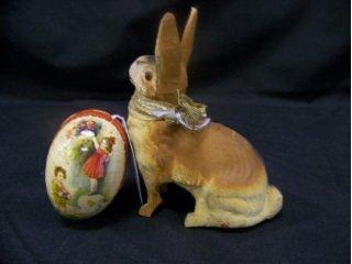 5013: German papier mache sitting rabbit candy containe