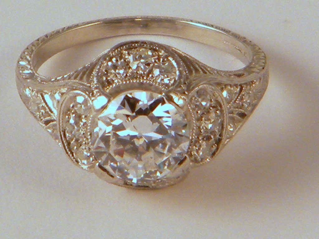 254: A platinum diamond ring, with a 1.33 ct center