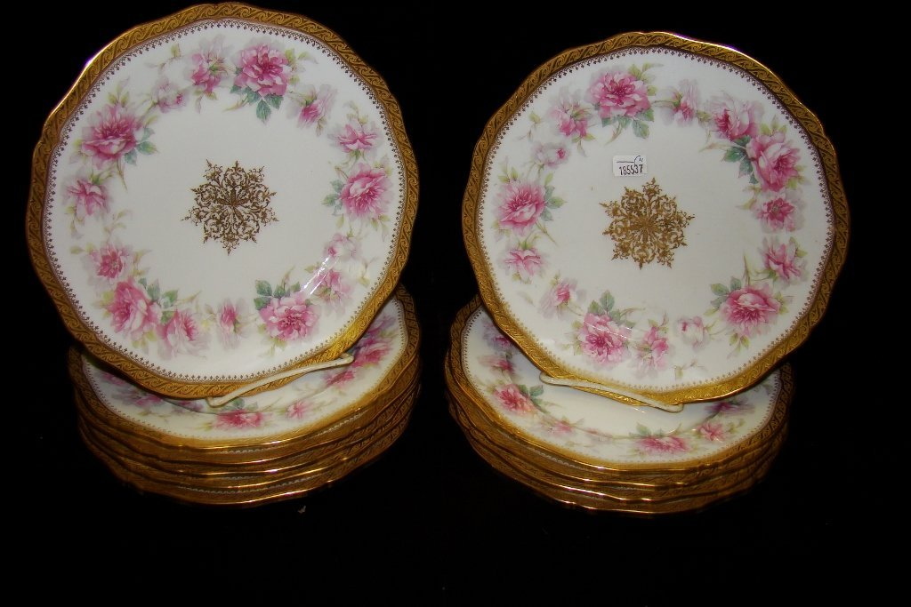 """14: Eleven 9"""" Haviland plates decorated with pink flowe"""
