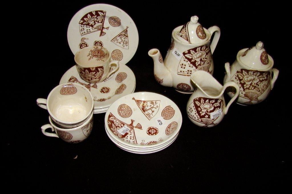 19: A 14-piece Aesthetic Movement child's tea set inclu