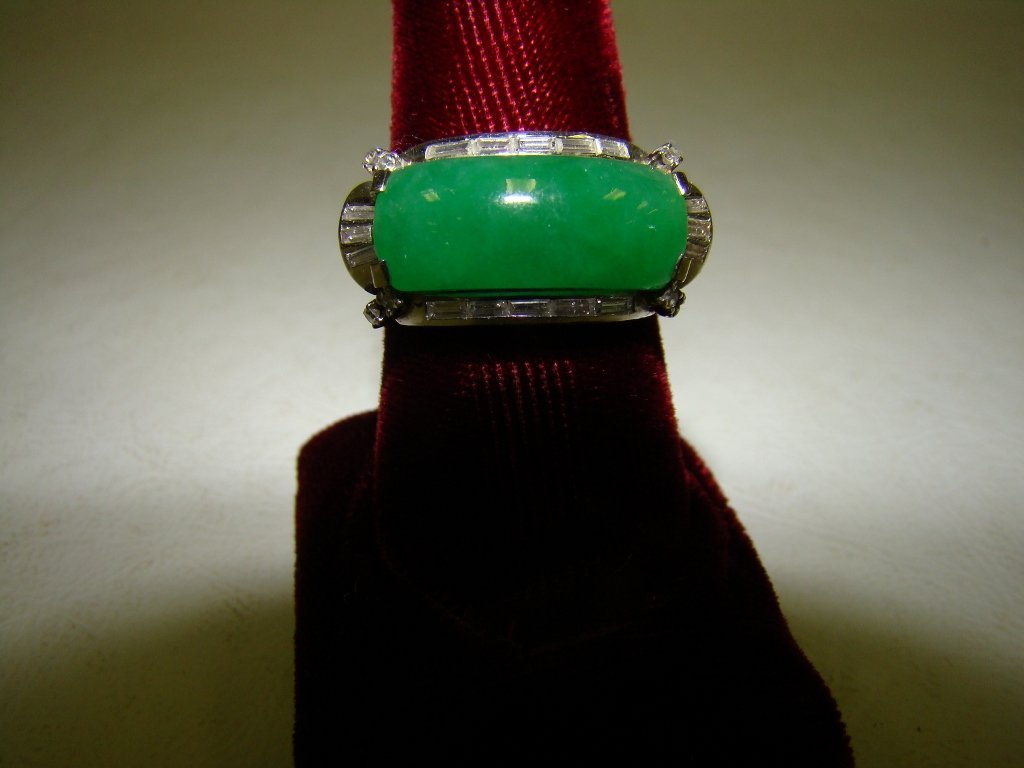 273: A platinum and jade ring with 16 baguette diamonds