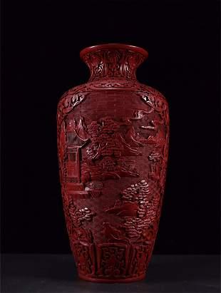 A Carved Lacquer Landscape Patterned Vase